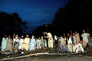 ISLAMABAD, PAKISTAN - MAY 21: Islamic students of Jamia Faridia madrassa in Islamabad, block the road to their mosque after reportedly taking 3 police hostage in response to alleged police intimidation, May 21, 2007 in Islamabad, Pakistan. The hardline students, who have repeatedly faced-off with authorities in the capital, are now holding 5 police officers hostage and demanding the release of dozens of students arrested by police. (Photo by Warrick Page)