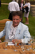 Michael Palin Cartier Style Et Luxe, Goodwood, 27 June 2004. SUPPLIED FOR ONE-TIME USE ONLY-DO NOT ARCHIVE. © Copyright Photograph by Dafydd Jones 66 Stockwell Park Rd. London SW9 0DA Tel 020 7733 0108 www.dafjones.com