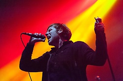 © Licensed to London News Pictures. 23/01/2015. London, UK.   No Devotion performing live at Brixton Academy, supporting headliner Gerard Way.  In this picture Geoff Rickly.  No Devotion are a Welsh/American alternative rock band formed by American singer Geoff Rickly (formerly of the band Thursday) and former members of the Welsh band Lostprophets. Lostprophets were a Welsh rock band, formed in 1997, which disbanded in October 2013 after its singer Ian Watkins was charged with multiple child sex offenses and later convicted. No Devotion consist of members  Lee Gaze (lead guitar, backing vocals),  Mike Lewis (rhythm guitar, backing vocals), Jamie Oliver (vocals, piano), Stuart Richardson (bass guitar), Geoff Rickly (lead vocals).  Photo credit : Richard Isaac/LNP