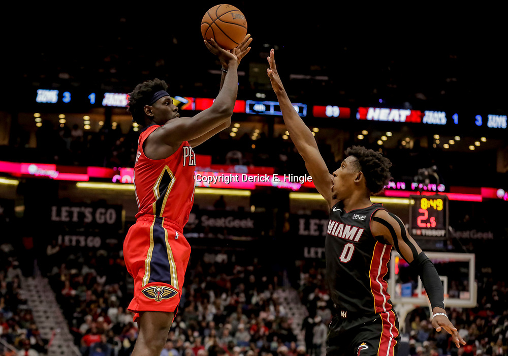 Dec 16, 2018; New Orleans, LA, USA; New Orleans Pelicans guard Jrue Holiday (11) shoots oer Miami Heat guard Josh Richardson (0) during the second half at the Smoothie King Center. Mandatory Credit: Derick E. Hingle-USA TODAY Sports