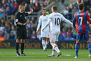 Wayne Rooney of Manchester United and Referee Mike Jones during the Barclays Premier League match between Crystal Palace and Manchester United at Selhurst Park, London, England on 31 October 2015. Photo by Ellie Hoad.