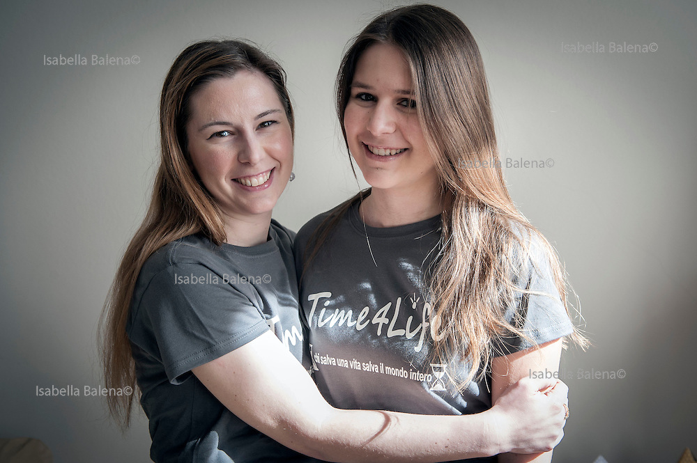 Elisa Fangareggi, Modena, march 2013. Fondatrice dell'associazione di volontariato Time4life a casa sua. Leader of Time4life association at her home. With her daughter Bianca (13)