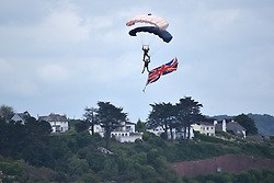 © Licensed to London News Pictures.  03/06/2017; Torbay, Devon, UK. The Tigers parachute display team with a Union Jack flag at the Torbay Airshow 2017. The 2017 Torbay Airshow returns this weekend on Saturday 3 and Sunday 4 June with an action packed programme of world class air displays. The world's premier aerobatic team The Red Arrows will be debuting a new routine in the first display of their season, featuring their trademark combination of close formations and precision flying. The full display programme for the weekend begins on the Saturday between 2-3pm with The Tigers Freefall Parachute Display Team, Team Raven Aerobatic Display Team, the Percival Piston Provost and the Strikemaster. From 3-4pm will be the highly anticipated display by the Red Arrows, former British Female Aerobatic Champion Lauren Richardson in her Pitts Special S1-S and world aerobatic competitor Gerald Cooper in his Xtreme XA41. Finishing off the action packed afternoon from 4-5pm will see displays from the AutoGyro, the Battle of Britain Memorial Flight aircraft, the PBY5A Catalina seaplane, The Blades and the Royal Air Force's Typhoon FGR4. Sunday afternoon will see each of the aircraft take to the skies again before the weekend closes with a final display from the RAF Chinook team. The two day show, which had its inaugural event last year, takes place on Paignton Green with the Bay providing a stunning natural amphitheatre for viewing the air displays and the perfect location for a large coastal airshow event. To stay up to date with the latest Torbay Airshow news and updates follow @torbayairshow on Facebook, Twitter and Instagram or visit www.torbayairshow.com. Picture credit : Simon Chapman/LNP