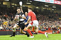 Rugby Union - 2019 / 2020 season - Wales vs. Barbarians<br /> <br /> Shaun Stevenson of the Barbarians   & Josh Adams of Wales , at The Principality (Millennium) Stadium.<br /> <br /> COLORSPORT/WINSTON BYNORTH
