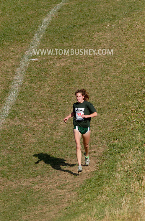 Warwick, N.Y. - Mary Kate Champagne of Seton Catholic High School runs down a hill in the lead during the girls' Class D race at the New York State Public High School Athletic Association cross countryh championships at Sanfordville Elementary School on Nov. 11, 2006.<br />