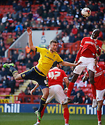 Middlesbrough FC defender Ben Gibson (6) and Charlton Athletic midfielder Alou Diarra (12) jump for a header  during the Sky Bet Championship match between Charlton Athletic and Middlesbrough at The Valley, London, England on 13 March 2016. Photo by Andy Walter.