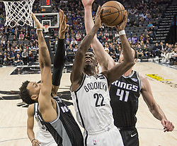 March 1, 2018 - Sacramento, CA, USA - The Brooklyn Nets' Caris LeVert (22) puts up a shot against the Sacramento Kings' Skal Labissiere (7) and Kosta Koufos (41) at the Golden 1 Center in Sacramento, Calif., on Thursday, March 1, 2018. (Credit Image: © Hector Amezcua/TNS via ZUMA Wire)