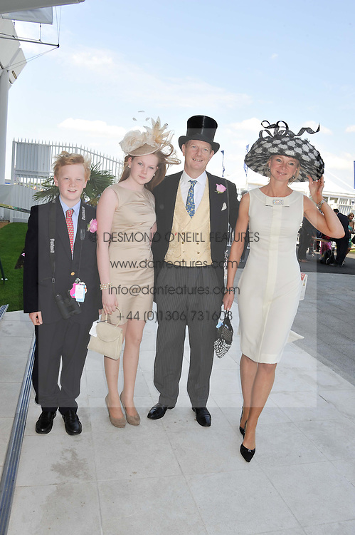 Left to right, the EARL & COUNTESS OF DERBY and their children the LORD STANLEY and LADY HENRIETTA STANLEY at the Investec Derby at Epsom Racecourse, Epsom Downs, Surrey on 4th June 2011.