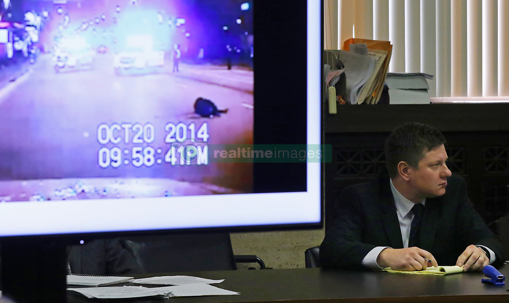 October 3, 2018 - Chicago, IL, USA - A police vehicle dash cam video of the moments after Laquan McDonald was fatally shot is displayed for jurors as Chicago police Officer Jason Van Dyke attends his trial for the shooting death of McDonald, at the Leighton Criminal Court Building Wednesday, Oct. 3, 2018, in Chicago. (Credit Image: © John J. Kim/Chicago Tribune/TNS via ZUMA Wire)