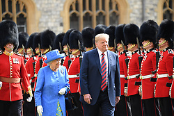 Ministry of Defence handout photo of US President Donald Trump and Queen Elizabeth II inspecting a Guard of Honour, formed of the Coldstream Guards, at Windsor Castle, Windsor.