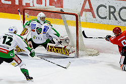 Jean-Philippe Lamoureux (HDD Tilia Olimpija, #1) with a huge save on one timer shot by James Sixsmith (HK Acroni Jesenice, #9) during of ice-hockey match between HK Acroni Jesenice and HDD Tilia Olimpija in 13th Round of EBEL league, on October 21, 2011 at Hala Tivoli, Ljubljana, Slovenia. (Photo By Matic Klansek Velej / Sportida)