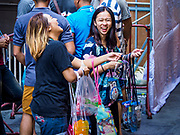 13 APRIL 2018 - BANGKOK, THAILAND:  Vendors selling waterproof cases for smart phones on Silom Road during the first day of Songkran in Bangkok. Songkran is the traditional Thai New Year celebration best known for water fights.     PHOTO BY JACK KURTZ