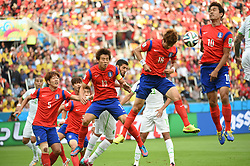 June 22, 2014  Porto Alegre, Brazil. Players from the Republic of Korea compete for the ball during their Group H match against Algeria during their 2014 FIFA World Cup at the Estadio Beira-Rio Stadium in Porto Alegre, Brazil.  Algeria defeated the Korean Republic 4:2. (Credit Image: © Xinhua via ZUMA Wire)