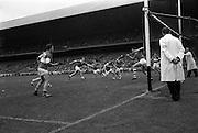 06/09/1964<br /> 09/06/1964<br /> 6 September 1964<br /> All-Ireland Minor Final: Cork v Laois at Croke Park, Dublin.<br /> Cork full back, G. Ahern (left).