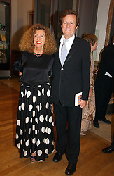 NICOLE FARHI and SIR DAVID HARE at The Royal Academy dinner before the official opening of the Summer Exhibition held at the Royal Academy of Art, Burlington House, Piccadilly, London W1 on 6th June 2006.<br />