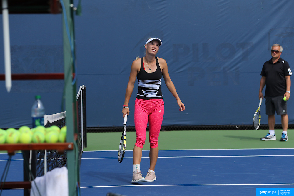 Caroline Wozniacki, Denmark, on the practice courts with her father and coach Piotr Wozniacki before the 1st round of the Connecticut Open at the Connecticut Tennis Center at Yale, New Haven, Connecticut, USA. 17th August 2014. Photo Tim Clayton