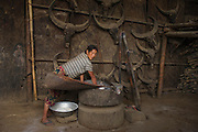 Konyak Naga winnowing rice<br /> Konyak Naga headhunting Tribe<br /> Mon district<br /> Nagaland,  ne India