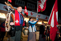 Olympic fans gather outside of the House of Switzerland to cheer on their gold-medal athletes during the 2010 Olympic Winter games in Whistler, BC Canada.