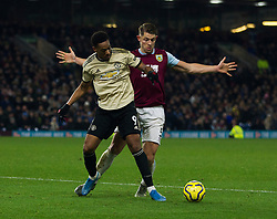 Anthony Martial of Manchester United and James Tarkowski of Burnley (R) in action - Mandatory by-line: Jack Phillips/JMP - 28/12/2019 - FOOTBALL - Turf Moor - Burnley, England - Burnley v Manchester United - English Premier League