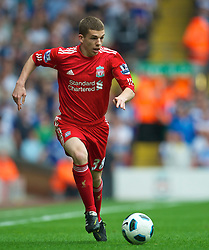 LIVERPOOL, ENGLAND - Saturday, April 23, 2011: Liverpool's John Flanagan in action against Birmingham City during the Premiership match at Anfield. (Photo by David Rawcliffe/Propaganda)