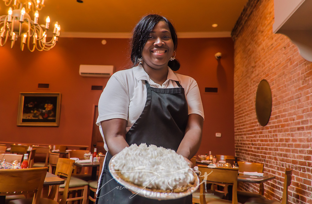 Kimberly Smith holds a lemon icebox pie at Crystal Grill in Greenwood, Miss. The pie, along with the restaurant's chocolate meringue and coconut merengue pies, consistently earns high marks from patrons. (Photo by Carmen K. Sisson/Cloudybright)
