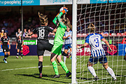 Megan Walsh (GK) (Brighton) saves the ball despite the best effort from Maren Mjelde (Chelsea) to prevent the save during the FA Women's Super League match between Brighton and Hove Albion Women and Chelsea at The People's Pension Stadium, Crawley, England on 15 September 2019.