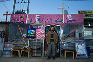 41 year-old Nashwan Yousif Zahra has been living in the Christian refugee camp for two years. He fled his home city of Qaraqosh because of the Islamic State's advance in August, 2014. He owns the shop for a year and a half, spent  2 million dinar building it. Back in Qaraqosh he used to run a sweet shop.