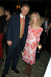 RICHARD & BASIA BRIGGS at a party to celebrate the publication of 'Next To You' - Caron's Courage remembered by her mother Gloria Hunniford held on Caron's birthday at The Hilton Park Lane, London on 5th Octobe 2005.<br /><br />NON EXCLUSIVE - WORLD RIGHTS