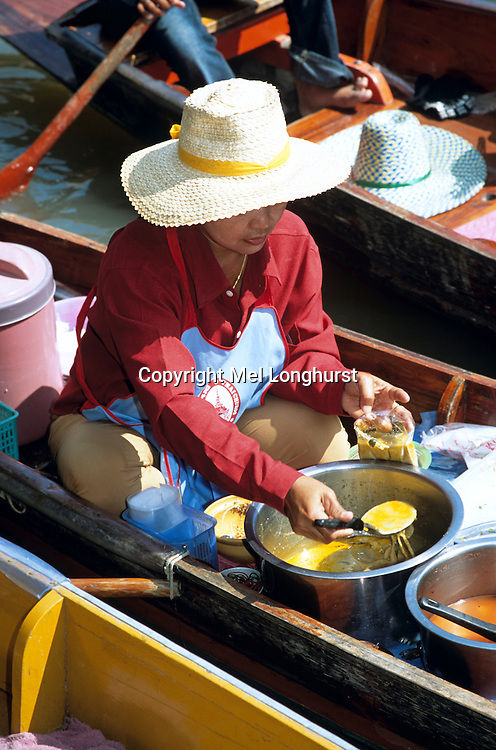 Woman selling food, Damnoen Saduak floating market, Ratchaburi Province, near Bangkok, Thailand