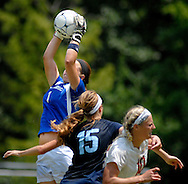 26 MAY 2012 -- TOWN & COUNTRY, Mo. -- St. Dominic High School soccer goalie Megan Swanson leaps to make a save as her teammate Sydni Young (15) and Visitation Academy player Jade Klump (10) collide during the MSHSAA Class 2 girls' soccer quarterfinals at Visitation Saturday, May 26, 2012. St. Dominic topped the Vivettes 8-1 to advance to Friday's semifinals against Helias Catholic High School at Blue Springs South High School. Photo © copyright 2012 Sid Hastings.