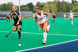 Virginia Cavaliers midfielder Paige Selenski (21) sends the ball down the sidelines past Providence Friars forward/midfielder Joscelyn Mahon (5).  The Virginia Cavaliers field hockey team defeated the Providence College Friars on the University Hall Turf Field on the Grounds of the University of Virginia in Charlottesville, VA on August 31, 2008.