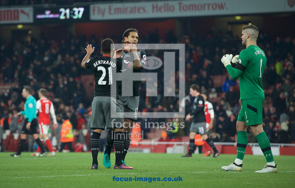 Ryan Bertrand, (left) Virgil van Dijk and Goalkeeper Fraser Forster of Southampton celebrate their 0-2 win in the EFL Cup match at the Emirates Stadium, London<br /> Picture by Alan Stanford/Focus Images Ltd +44 7915 056117<br /> 30/11/2016