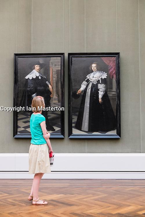 Visitors looking at paintings at Gemaldegalerie art museum at Kulturforum in Berlin Germany