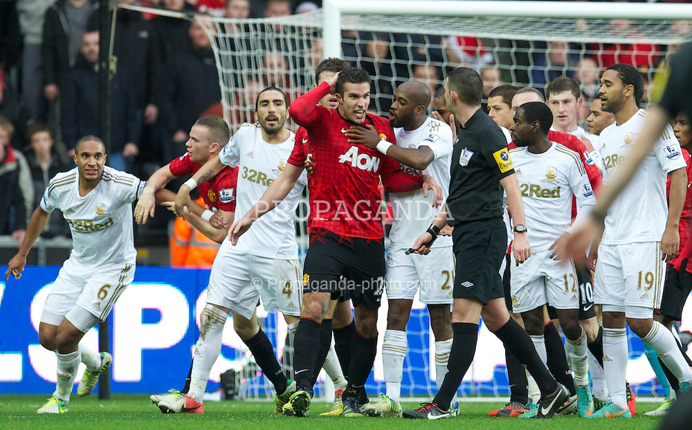SWANSEA, WALES - Sunday, December 23, 2012: Manchester United's Robin van Persie screams at the referee after a melee with Swansea City's captain Ashley Williams during the Premiership match at the Liberty Stadium. (Pic by David Rawcliffe/Propaganda)