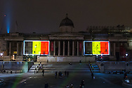 The National Gallery in Trafalgar Square is illuminated in the colours of the Belgian flag in a display of solidarity with Belgium following the terror attacks on March 22nd. Westminster, London<br /> Picture by Paul Davey/Focus Images Ltd +447966 016296<br /> 23/03/2016