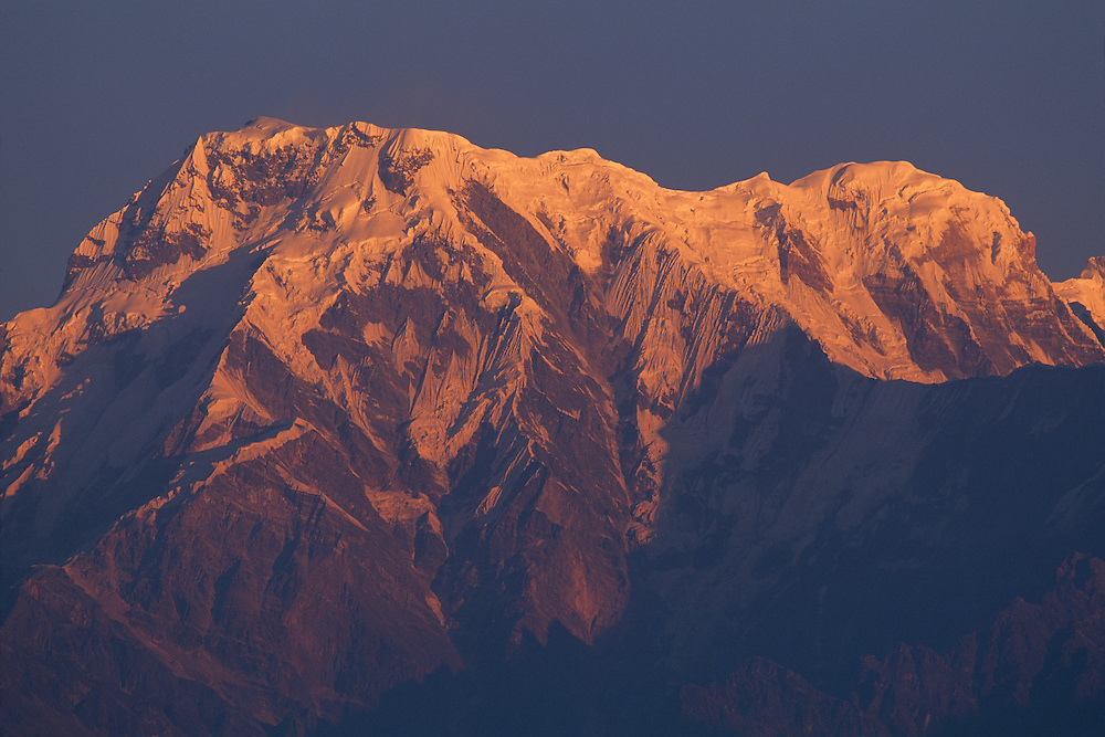 Nepal, Sarangkot, Morning sun lights snow-covered peaks in the Annapurna Massif in the Himalayan Mountains