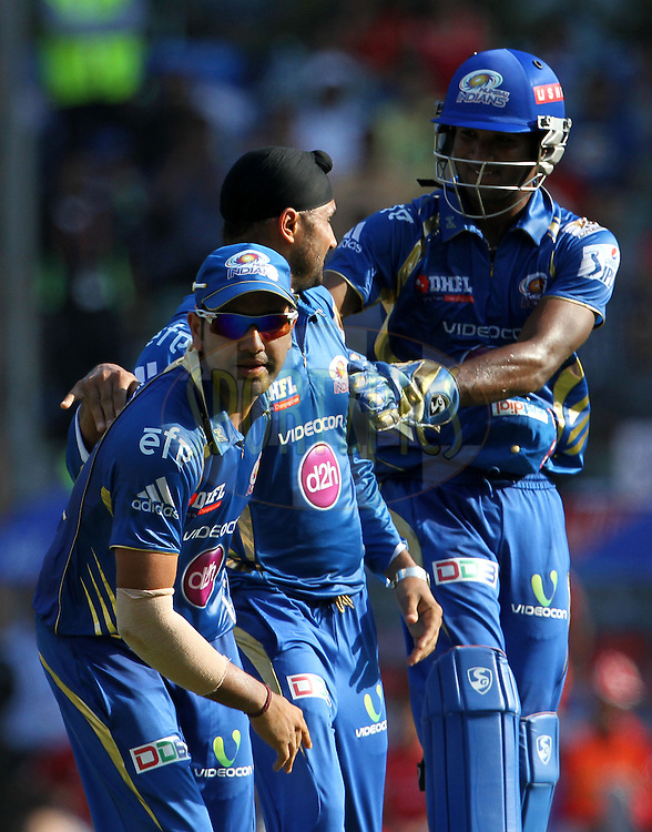 Mumbai Indians players celebrates after getting the wicket of Glenn Maxwell of the Kings X1 Punjab during match 22 of the Pepsi Indian Premier League Season 2014 between the Mumbai Indians and the Kings XI Punjab held at the Wankhede Cricket Stadium, Mumbai, India on the 3rd May  2014<br /> <br /> Photo by Vipin Pawar / IPL / SPORTZPICS<br /> <br /> <br /> <br /> Image use subject to terms and conditions which can be found here:  http://sportzpics.photoshelter.com/gallery/Pepsi-IPL-Image-terms-and-conditions/G00004VW1IVJ.gB0/C0000TScjhBM6ikg