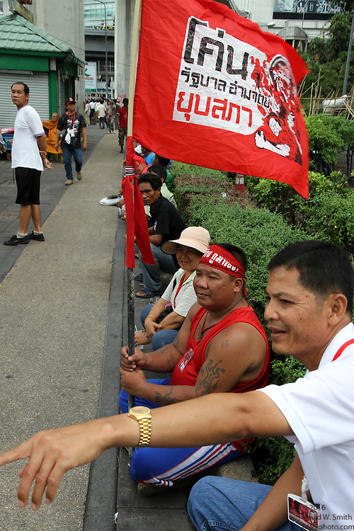 Protestors sit on the occupied street side during the Red Shirts anti-government protest in the Silom area of Bangkok.