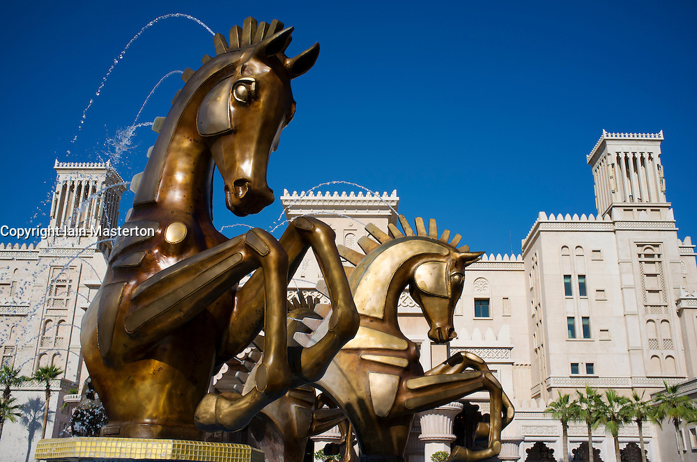 Elaborate statues of horses at entrance to luxury Al Qasr hotel in Madinat Jumairah resort complex in Dubai in United Arab Emirates