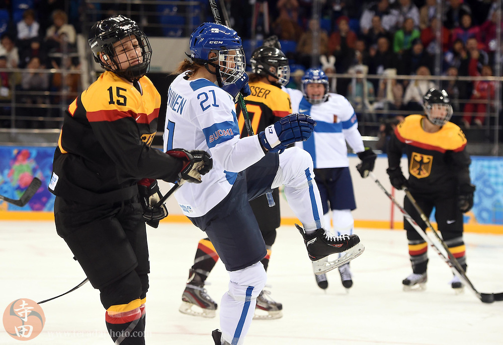 Feb 16, 2014; Sochi, RUSSIA; Finland forward Michelle Karvinen (21) celebrates after scoring a goal against Germany in the women's ice hockey classifications round during the Sochi 2014 Olympic Winter Games at Shayba Arena.