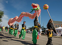 Performers from Wah Lum Kung Fu march the parade of nations down Beacon Street towards Rotary park during Saturday's Multi Cultural Festivities.  The Dragon signifies blessings from heaven and positive karma.   (Karen Bobotas/for the Laconia Daily Sun)