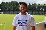 AFC Wimbledon defender Will Nightingale (5) wearing a Lead us home T shirt during the EFL Sky Bet League 1 match between AFC Wimbledon and Accrington Stanley at the Cherry Red Records Stadium, Kingston, England on 17 August 2019.