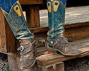 The boots, spurs, and chaps are functional pieces of equipment used every day by the American cowboy. As well as being functional they can be quite decorative and the spurs are often inlayed with silver or gold. The 'tall top' boots are a favorite of the working cowboy.