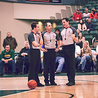 Referees during the Men's Basketball Home Game on Sat Feb 02 at Centre for Kinesiology,Health and Sport. Credit: Arthur Ward/Arthur Images