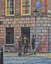 © Licensed to London News Pictures. 12/09/2017. London, UK. Extras stand on a street corner as new television series 'Vanity Fair' is filmed in Sptalfields in London. The mini series is being made for ITV and Amazon Prime and stars Tom Bateman and Michael Palin. Photo credit: Graham Long/LNP