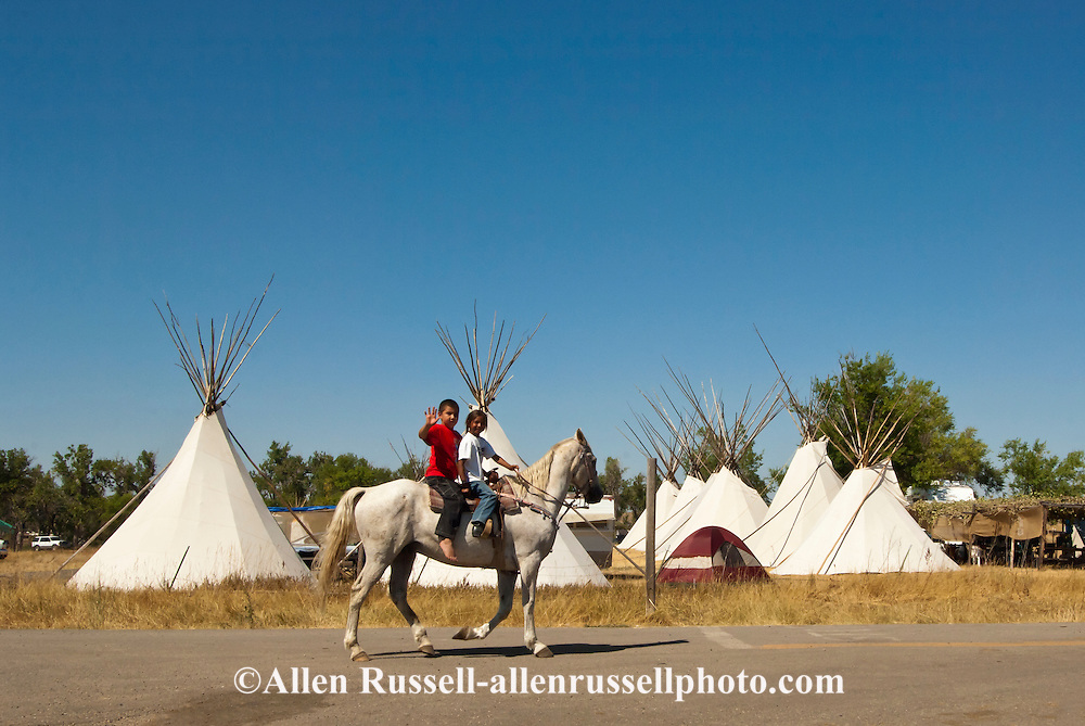 Crow Fair, Crow Indian Reservation, Montana, young horseback riders