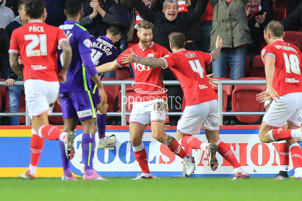 Bristol City defender Nathan Baker celebrates his goal during the Sky Bet Championship match between Bristol City and Charlton Athletic at Ashton Gate, Bristol, England on 26 December 2015. Photo by Jemma Phillips.
