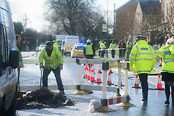 © London News Pictures. 15/02/2014. Hemel Hempstead, UK.  A gas works repair team carrying to emergency work at the scene where a giant sinkhole measuring 35ft wide by 20ft deep has opened up next to a house in Hemel Hempstead, Hertfordshire.  Photo credit: Ben Cawthra/LNP