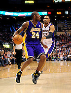 Feb. 19, 2012; Phoenix, AZ, USA;  Los Angeles Lakers guard Kobe Bryant (24) handles the ball against the Phoenix Suns forward Grant Hill (33) during the first half at the US Airways Center.  Mandatory Credit: Jennifer Stewart-US PRESSWIRE.