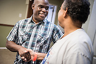 The Rev. Gregory T. Manning, pastor of Gloria Dei Lutheran Church,  shakes hands with Ronnie Seaton, Sr., a volunteer who attends Gloria Dei, at the Broadmoor Food Pantry next to the church on Wednesday, March 9, 2016, in New Orleans. LCMS Communications/Erik M. Lunsford